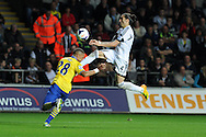 Swansea city's Chico Flores (4) challenges Arsenal's Keiran Gibbs. Barclays Premier league, Swansea city v Arsenal at the Liberty Stadium in Swansea on Saturday 28th Sept 2013.  pic by Andrew Orchard, Andrew Orchard sports photography.