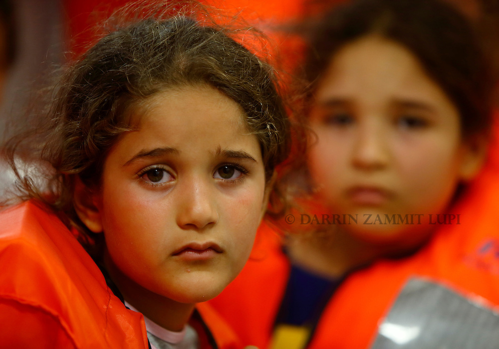 Migrant children on the Migrant Offshore Aid Station (MOAS) ship MV Phoenix wait to be transferred to the Norwegian ship Siem Pilot off the coast of Libya August 6, 2015.  An estimated 700 migrants on an overloaded wooden boat were rescued 10.5 miles (16 kilometres) off the coast of Libya by the international non-governmental organisations Medecins san Frontiere (MSF) and MOAS without loss of life on Thursday afternoon, according to MSF and MOAS, a day after more than 200 migrants are feared to have drowned in the latest Mediterranean boat tragedy after rescuers saved over 370 people from a capsized boat thought to be carrying 600.<br /> REUTERS/Darrin Zammit Lupi <br /> MALTA OUT. NO COMMERCIAL OR EDITORIAL SALES IN MALTA