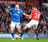 20111226: LONDON, UK - Barclays Premier League 2011/2012:  <br /> Manchester United vs Wigan Athletic.<br /> In photo: Conor Sammon of Wigan Athletic tackled by Darron Gibson of Manchester United.<br /> PHOTO: CITYFILES
