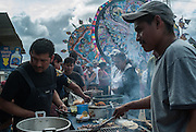 Food vendors grill fresh meat, Festival de Barriletes, Sumpango Guatemala.