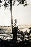 young adult farmer with goat that is on a lease circa 1940s Holland