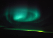 Beautiful display of northern lights including circular arcs, rays and bands north of the Arctic Circle near Bettles, Alaska.