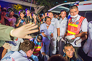 """10 NOVEMBER 2012 - BANGKOK, THAILAND:  Medics and nurses from the Ruamkatanya Foundation on the scene of a fatal accident involving a child near the Klong Toey slum in Bangkok. The Ruamkatanyu Foundation was started more than 60 years ago as a charitable organisation that collected the dead and transported them to the nearest facility. Crews sometimes found that the person they had been called to collect wasn't dead, and they were called upon to provide emergency medical care. That's how the foundation medical and rescue service was started. The foundation has 7,000 volunteers nationwide and along with the larger Poh Teck Tung Foundation, is one of the two largest rescue services in the country. The volunteer crews were once dubbed Bangkok's """"Body Snatchers"""" but they do much more than that now.    PHOTO BY JACK KURTZ"""