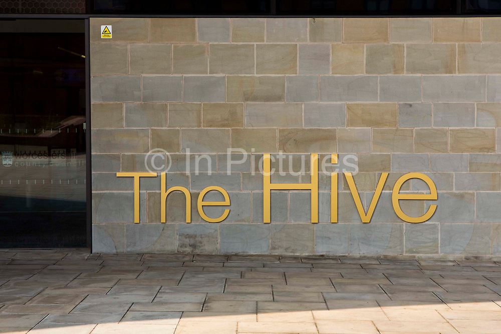 The sign outside the main entrance to  The Hive in Worcester. The first fully integrated university and public library in the UK. It also houses the county archives and archaeology service, the local history centre and local authority hub. The building is low energy. Worcester, UK.