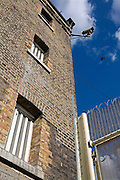 CCTV cameras look over the prison grounds. HMP Wandsworth, London, United Kingdom