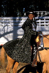 African American woman riding a horse