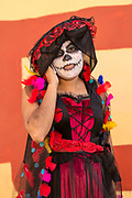 A woman in Catrina costume talks on her mobile phone during celebrations for the Day of the Dead festival known in Spanish as Día de Muertos at the town square October 31, 2013 in Oaxaca, Mexico.  The festival celebrates the lives of those that died.