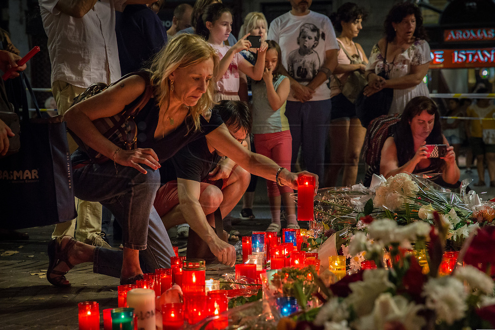 """After the terrorists attacks on the Rambla de Canaletes on 17 August in Barcelona, thousands of people have approached to the place to express their sadness and solidarity. In the  Canaletes fountain multitude of messages and candles have accumulated , also in other places of the Ramblas where the victims were killed. The motto """"no tenim por"""" meaning """"we are not scared"""" has flooded the streets and social networks. Place: Canaletes Fountain in Barcelona. Date: august 19, 2017. Photo: Eva Parey/4SEE"""