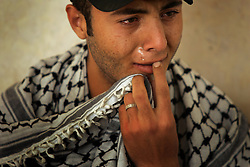 A Palestinian man mourns as the news of Yasser Arafat's death spread, Gaza, Palestinian Territories, Nov. 11, 2004. Arafat died in a Paris hospital at the age of 75.