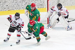 Berhard Fechtig of Austria vs Pijus Rulevicius and Laisvydas Rimkus of Lithuania during the ice hockey match between National teams of Lithuania (LTU) and Austria (AUT) at 2011 IIHF World U20 Championship Division I - Group B, on December 12, 2010 in Ice skating Arena, Bled, Slovenia.  (Photo By Vid Ponikvar / Sportida.com)