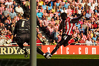 Photo: Jed Wee.<br />Sunderland v Sheffield Wednesday. Coca Cola Championship. 30/09/2006.<br /><br />Sunderland's Dwight Yorke (R) fires a shot in on goal.