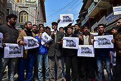March 22, 2019 - Srinagar, J&K, India - Demonstrators seen holding  poster pictures with an image of Rizwan Pandit during the protest..Supporters of the Jammu Kashmir Liberation Front JKLF held a protest against the death of a school teacher in police custody after he was arrested in connection with a terror case investigation. (Credit Image: © Saqib Majeed/SOPA Images via ZUMA Wire)