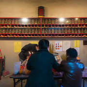 Two senior ladies in Man Mo temple in hong Kong