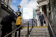 On the day that Chancellor of the Exchequer Rishi Sunak unveiled a £30bn package to boost the economy and get the country through the coronavirus outbreak, Londoners climb the steps from Bank Underground Station in the capital's financial district, beneath the walls of the Bank of England as its governor Mark Carney cut the interest rate from 0.75% to 0.25%, on 11th March 2020, in the City of London, England.