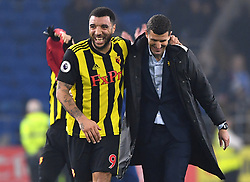Watford's Troy Deeney (left) and manager Javi Gracia celebrate after the final whistle during the Premier League match at the Cardiff City Stadium.