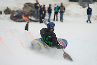 Kayakers manuever through the snow course during the 3rd annual Boat Bash Snow Crash event at Franklin's Veteran's Memorial Ski Hill on Saturday.  (Karen Bobotas/for the Laconia Daily Sun)