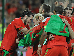 Gareth Bale of Wales celebrates with Jonathan Williams as Wales qualify for Euro 2016 - Mandatory byline: Dougie Allward/JMP - 07966 386802 - 13/10/2015 - FOOTBALL - Cardiff City Stadium - Cardiff, Wales - Wales v Andorra - European Qualifier 2016 - Group B