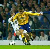Photo. Jed Wee<br /> Leeds United v Southampton, FA Barclaycard Premiership, Elland Road, Leeds. 26/08/2003.<br /> Leeds' Dominic Matteo (L) sticks out a leg to bring down Southampton's Kevin Phillips.
