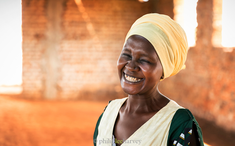 Portrait of mid-adult woman laughing, Musoto, Mbale, Uganda