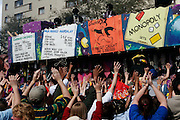 New Orleans, Louisiana. United States. February 28th 2006..People ask for beads and presents at the Zulu Parade on Saint Charles Avenue.