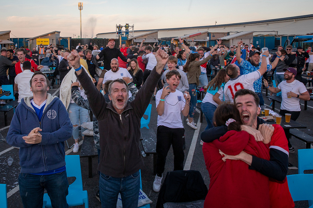 England fans celebrate a goal during the Euro 2020 semi final match between England and Denmark on the 7th of July 2021 at the outdoor screen at Folkestone Harbour Arm, in Folkestone, United Kingdom. (photo by Andrew Aitchison / In pictures via Getty Images)