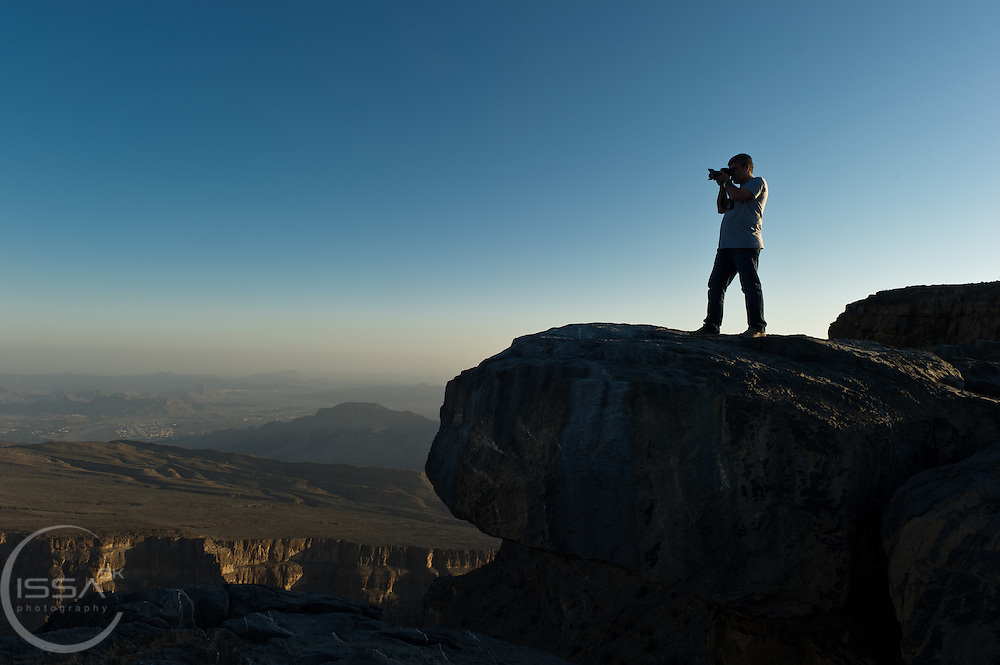 A photographer at Jabal Shams