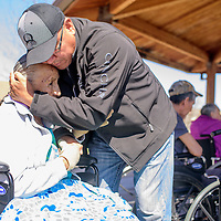 Larry Lynch hugs his mother Maxine Smith during a visit at Red Rock Care Center in Gallup Friday.