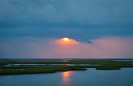 Sunset over the marsh past  Isle de Jean Charles Terribone Parish Louisiana.
