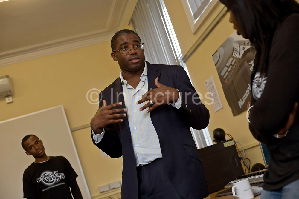 David Lammy, Member of Parliament for Tottenham and Minister for Skills, talks to youths, excluded from mainstream education at the Youth Vibes Project in Lewisham, South london