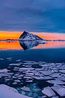 On a cloudy day, a window of sun comes at sunset, Vestvagoya Island, Lofoten Islands, Arctic, Northern Norway.