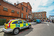 An NHS ambulance team is parked by the Tottenham Police Station in North London as people carrying banners, placards and flags are protesting against police brutality in front of Tottenham Police Station in London on Saturday, Aug 8, 2020. Black Lives Matter enters the 11th weekend of continuous demonstrations against racial injustice in Britain. (VXP Photo/ Vudi Xhymshiti)