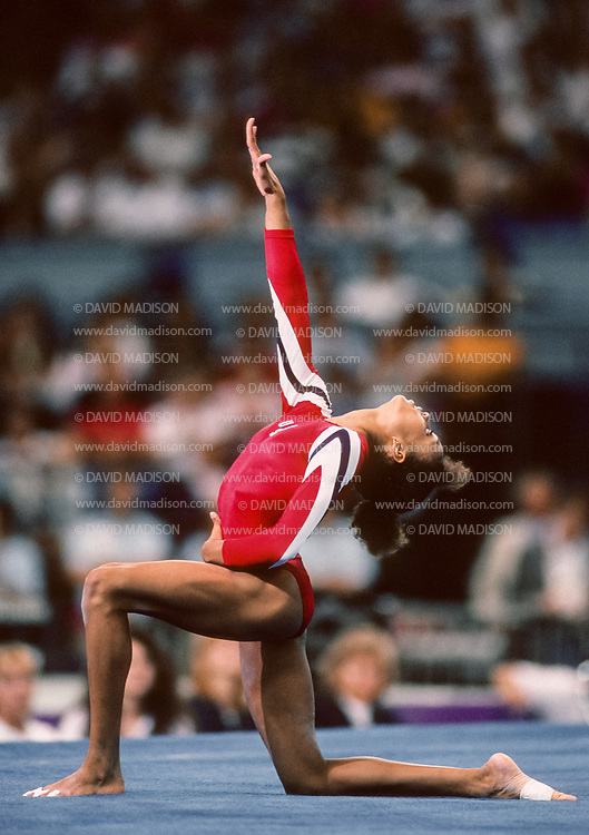 SEATTLE - JULY 1990:  Betty Okino of the United States performs in the floor exercise event during the gymnastics competition of the 1990 Goodwill Games held from July 20 - August 5, 1990.  The gymnastics venue was the Tacoma Dome in Tacoma, Washington.  (Photo by David Madison/Getty Images)