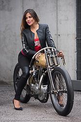 Moisa Silva Marinho models on PDF Motociclette's (Punto Di Fuga) custom 1927 Harley-Davidson JD Racer 1000cc that was on display at Motor Bike Expo. Verona, Italy. January 24, 2016.  Photography ©2016 Michael Lichter.