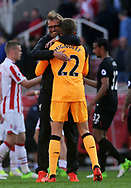 Liverpool goalkeeper Simon Mignolet is hugged by Jurgen Klopp , the Liverpool manager as they celebrate their win at the end of the game.  Premier league match, Stoke City v Liverpool at the Bet365 Stadium in Stoke on Trent, Staffs on Saturday 8th April 2017.<br /> pic by Bradley Collyer, Andrew Orchard sports photography.