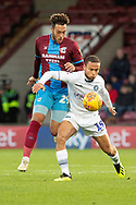 Wycombe Wanderers midfielder Curtis Thompson (18) holds back Scunthorpe United forward Kyle Wootton (29) during the EFL Sky Bet League 1 match between Scunthorpe United and Wycombe Wanderers at Glanford Park, Scunthorpe, England on 29 December 2018.