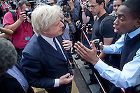 © London News Pictures. 09/08/11. Mayor of London, Boris Johnson visits Clapham Junction during the mass public clean up of the streets. This event has been organised through the social media of Twitter which was attended by up to 350 twitters. Photo credit Manu Palomeque/LNP