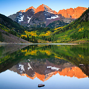 The sunrises over Maroon Lake at the base of the Aspen Snowmass Wilderness, Aspen, Colorado.