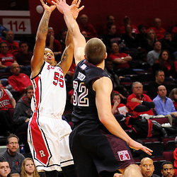 D'Von Campbell #55 of the Rutgers Scarlet Knights takes a shot over Dalton Pepper #32 of the Temple Owls during the second half of Rutgers men's basketball vs Temple Owls in American Athletic Conference play on Jan. 1, 2014 at Rutgers Louis Brown Athletic Center in Piscataway, New Jersey.