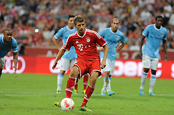 01.08.2013, Allianz Arena, Muenchen, Audi Cup 2013, FC Bayern Muenchen vs Manchester City, im Bild, Thomas MUELLER (FC Bayern Muenchen) verwandelt den Elfmeter zum 1:1 // during the Audi Cup 2013 match between FC Bayern Muenchen and Manchester City at the Allianz Arena, Munich, Germany on 2013/08/01. EXPA Pictures © 2013, PhotoCredit: EXPA/ Eibner/ Wolfgang Stuetzle<br /> <br /> ***** ATTENTION - OUT OF GER *****