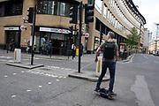 Man using a One Wheel motorised skateboard in London, England, United Kingdom.