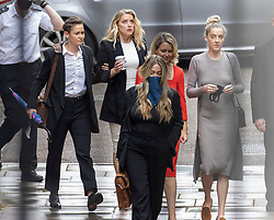 © Licensed to London News Pictures. 27/07/2020. London, UK. American actor AMBER HEARD (2L) arrives with Bianca Butti (L), lawyer Jennifer Robinson (in red) and sister Whitney Heard (R) at the High Court in London, where Johnny Depp is in a legal dispute with UK tabloid newspaper The Sun over allegations he assaulted his former wife, Amber Heard. Photo credit: Peter Macdiarmid/LNP