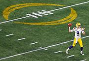 Quarterback Joe Burrow of LSU throws a pass during the Chick-fil-A Bowl/CFP semifinal in Atlanta, GA.