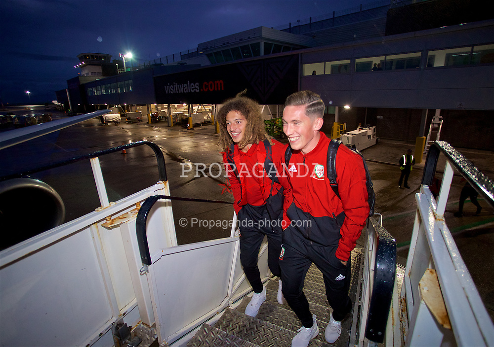 CARDIFF, WALES - Saturday, September 8, 2018: Wales' Ethan Ampadu (left) and Harry Wilson (right) board the team plane as the squad fly to Aarhus from Cardiff Airport ahead of the UEFA Nations League Group Stage League B Group 4 match against Denmark. (Pic by David Rawcliffe/Propaganda)