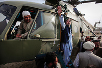 Nangahar Province, Afghanistan  -- Presidential candidate and former Foreign Minister Abdullah Abdullah waves to supporters as he boards an Afghan National Army Air Corps Mi-17 helicopter following a campaign rally speech in Gardi Village in the Nangahar Province on his campaign tour through the province. --  Photo by Jack Gruber, USA TODAY