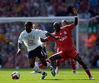 Photo: Jed Wee.<br />Liverpool v Tottenham Hotspur. The Barclays Premiership. 23/09/2006.<br /><br />Tottenham's Didier Zokora (L) beats Liverpool's Momo Sissoko.