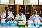 The staff of the hospital pharmacy putting together prescriptions for patients. St Walburg's Hospital, Nyangao. Lindi Region, Tanzania.