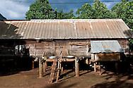 Wooden stilt house with sheets metal roof. Pleiku area, Vietnam, Asia