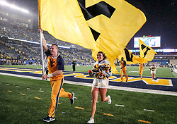 Sep 8, 2018; Morgantown, WV, USA; West Virginia Mountaineers cheerleaders celebrate after beating the Youngstown State Penguins at Mountaineer Field at Milan Puskar Stadium. Mandatory Credit: Ben Queen-USA TODAY Sports