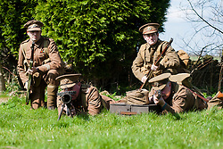 Renactors portraying the Cheshire Regiment of the first world war undertake training behind the Elm Tree Pub before they take part in a reenactment in Elmton in June..Ed Wilson gives covering fire with his Lee Enfield Rifle while Peter Austeridge and Stuart Oden-Walder (right) change the drum magazine on a Lewis machine gun<br /> 20 April  2013.Image © Paul David Drabble