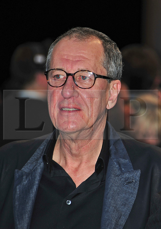 """© licensed to London News Pictures. London, UK  12/05/11 Geoffrey Rush attends the UK premiere of Pirates of the Carribean 4 """"on Stranger Tides"""" at Londons Westfield . Please see special instructions for usage rates. Photo credit should read AlanRoxborough/LNP"""